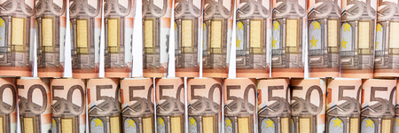 panorama with rolled 50 euro notes in front of white background
