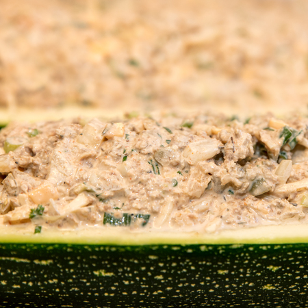 closeup, filled and stuffed zucchini or courgette, fresh and healthy selfmade meal