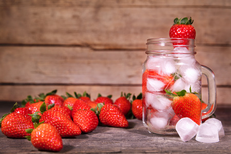 Detox or infused water with strawberries, fresh lemonade with icecubes, copyspace Stock Photo