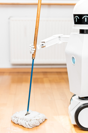 closeup of an robot with floor mop concept automatic floor scrubber in the household