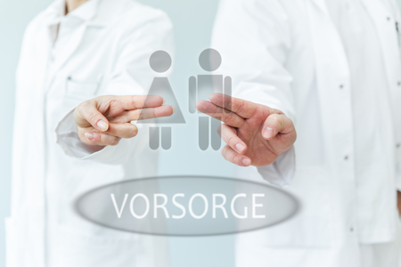two medical professionals are touching the button on a touchscreen with the german word vorsorge which means prevention.