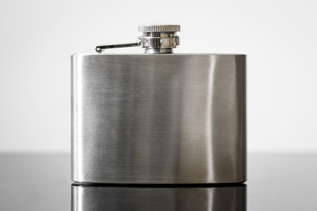 Hip flask with reflections, stainless steel, concept alcohol