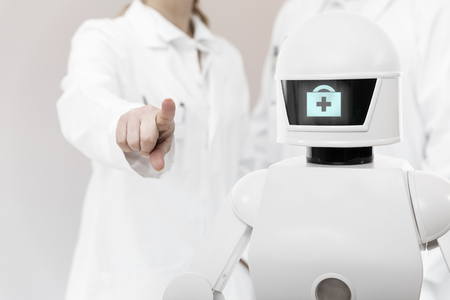 nursing care robot in a hospital or surgeon with copyspace, concept autonomous service robot supports the work of the professionals