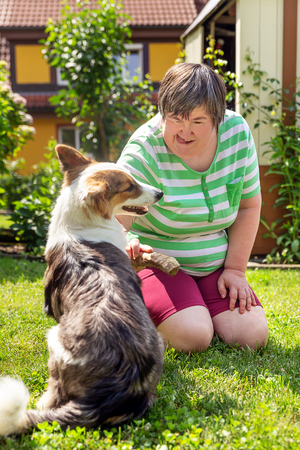 Mentally Disabled Woman With A Second Woman And A Companion Dog, Concept  Learning By Animal