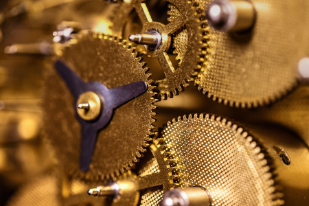 Closeup from a clockwork machinery, brassy gears or cogs