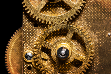 Macro Cogwheels from a aged Movement, concept Teamwork and Business Imagens