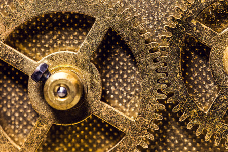 Brassy Cogwheels or Gearwheels, concept movement, precision and mechanical Imagens