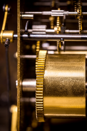 Closeup of a clockwork with cogs and brass