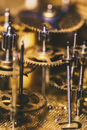 Details of a mechanical Clockwork or movement of a watch, brassy components Imagens