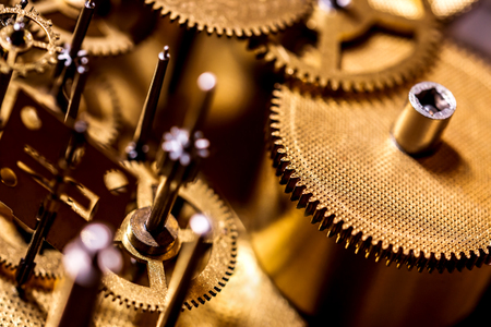 Gears and clockwork components details, concept Time and Horology, golden background