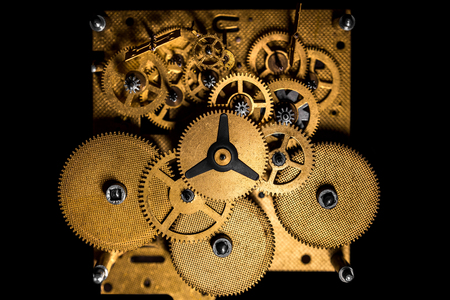 Topview, Inside view of a mechanical clockwork or movement, black background