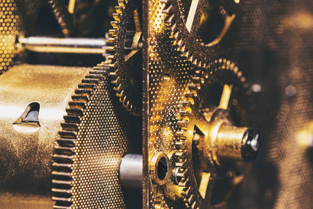 Closeup from Cogs or Gears into a clockwork, brass background