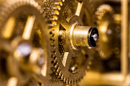 Closeup of brassy Gears, concept Teamwork and Togetherness, golden background