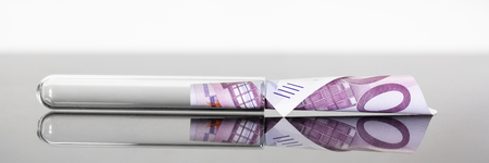 Concept image panoramic test tube with 500 euro banknote in it, concepts such as research fees or tuition, expensive medicine or pharmaceutical industry Stok Fotoğraf