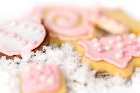 Sweet pink christmas cookies an with background, concept homemade bakery 写真素材