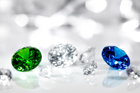 Polished jewels, diamond, blue sapphire and green emerald, flawless brilliant cut Stock Photo - 116276278