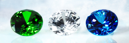 Three flawless brilliant cut jewels, sapphire, emerald and diamond, panorama