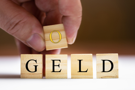 Concept investment, gold trading gold to make lot of money, geld means in german money