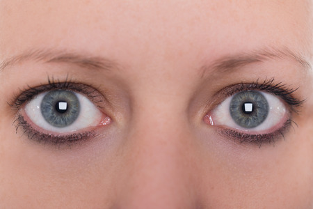 close up, blue eyes and eyebrows from a young woman