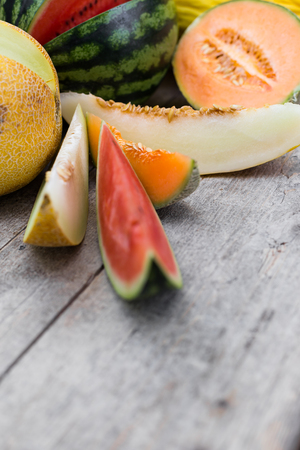 fresh colorful melon slices on a wooden table