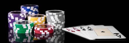 Gambling and casino, Playing cards and Poker Chips in front of black Background