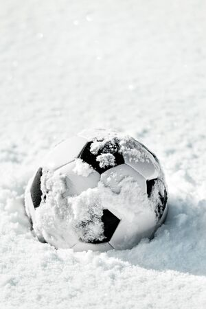 Soccer Ball in the Snow, Football closed season, Winter break for the kickers, copyspace