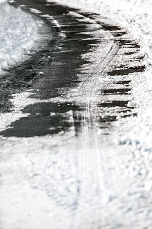 Country road at winter season, black ice and snow on the top, accident risk and danger, copyspace