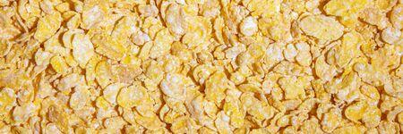 Topview banner, golden corn flakes background, cornflakes breakfast