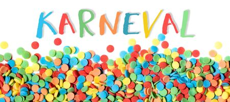 colorful sugar confetti on white background, german word karneval which means carnival 版權商用圖片