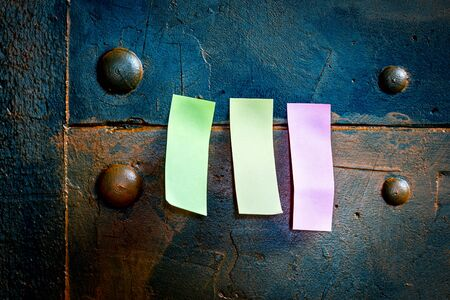 blue metallic pinboard with three memo postit paper with copyspace Stock Photo