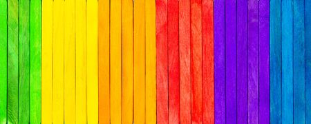Banner with colorful wooden picks, concept spectrum, panoply and chromatics, pattern background