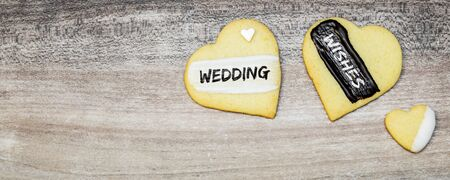 Heart shape cookies with text wedding wishes, banner with copyspace