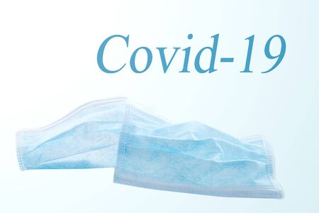 background with a blue surgical mask, concept corona virus or covid-19, sars-cov-2