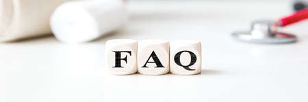Header, dices with word FAQ and medical office background, frequently asked questions