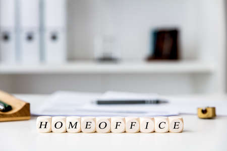 Office at home workplace with dices, english word homeoffice, stay safe in time of covid-19 pandemic Stockfoto