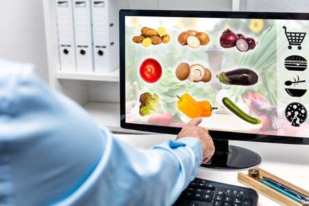 Businessman orders something healthy to eat at the office, concept delivery service from supermarket or fast food