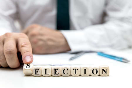 businessman or election worker changes the word election to selection, concept election in the usa