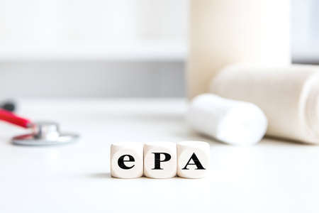 Medical office background with dice, word ePA, which means german electronic patient record, digital and electronic patient chart in germany Stockfoto