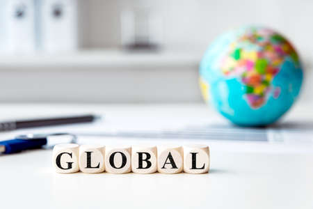 concept picture with globe in a bright office on a desk, concept global