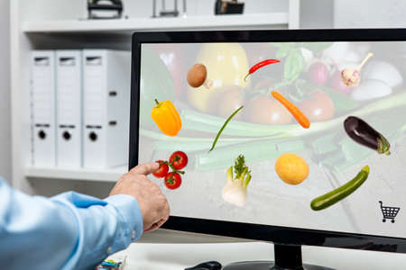Businessman ordering and shopping virtual food, home delivery and e-commerce, online and digital nutrition and grocery