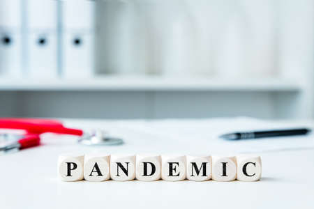 the word pandemic on wooden blocks in a doctor's office