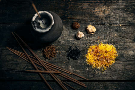 Flatlay of incense ingredients on wooden table, meditation and esoteric, joss sticks, resin and storax Stock Photo