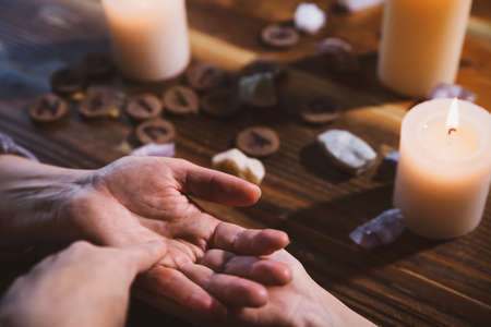 chiromancy and palm reading with a fortuneteller, oracle and horoscope, spirituality