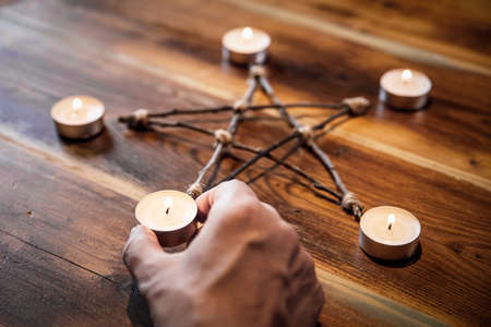 Preparation of an pentacle or pentagram, occultism and mystical ritual, closeup