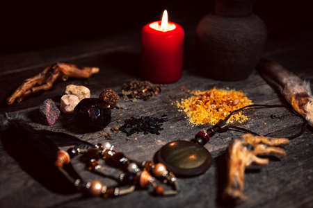 Voodoo or vodun ingredients for a dark ritual, witchcraft and african religion, talisman, incense, crow's feet and gems