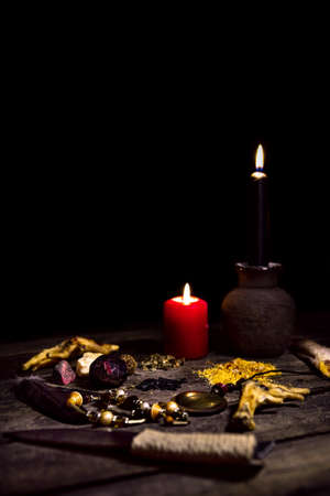 Dark vodun or voodoo ritual table in front of black background, magic and mystical african religion, copyspace