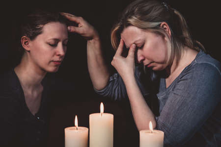 Prophesy and spiritually touching, telepath and esoteric contact, reading and healing, two women and candles