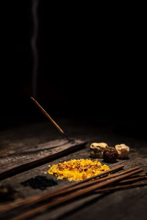 Joss sticks and esoteric and spiritually ingredients, incense and healing herbs, copyspace