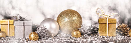 Panorama with shiny gold and silver christmas decoration