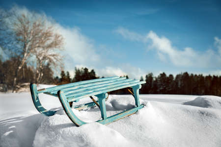 Beautiful winter time landscape with deep snow and a wooden sledge, winter holiday and vacation concept Stock fotó